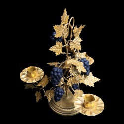 Gilted candle holder and black grapes