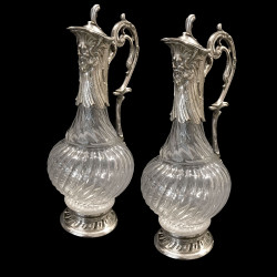 Pair of glass and silver plated ewers with Neptune mask